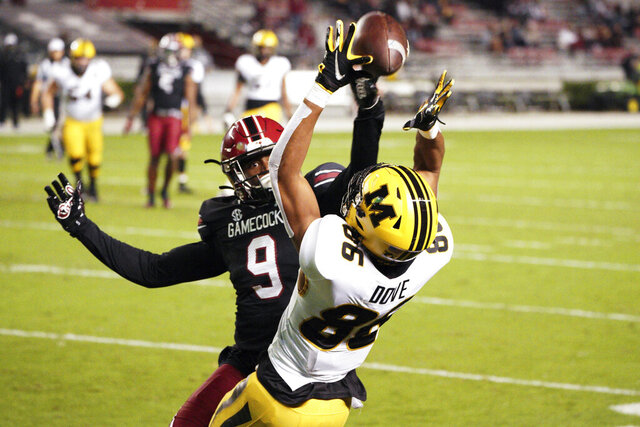 Missouri wide receiver Tauskie Dove (86) catches a touchdown pass against South Carolina defensive back Cam Smith (9) during the first half of an NCAA college football game Saturday, Nov. 21, 2020, in Columbia, S.C. (AP Photo/Sean Rayford)