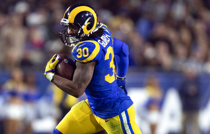 FILE - In this Dec. 16, 2018, file photo, Los Angeles Rams running back Todd Gurley sprints in an NFL football game against the Philadelphia Eagles in Los Angeles. Gurley loved to attend the Super Bowl as a fan the past few years. Now that he finally gets to play in it with the Rams, the star running back doesn't even care if he's sharing carries with C.J. Anderson. (AP Photo/Kyusung Gong, File)
