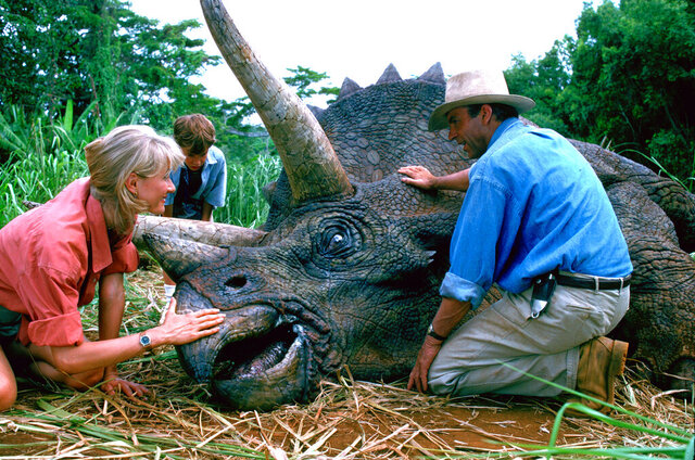 This image released by Universal Pictures shows, from left, Laura Dern, Joseph Mazzello and Sam Neill in a scene from the 1993 film