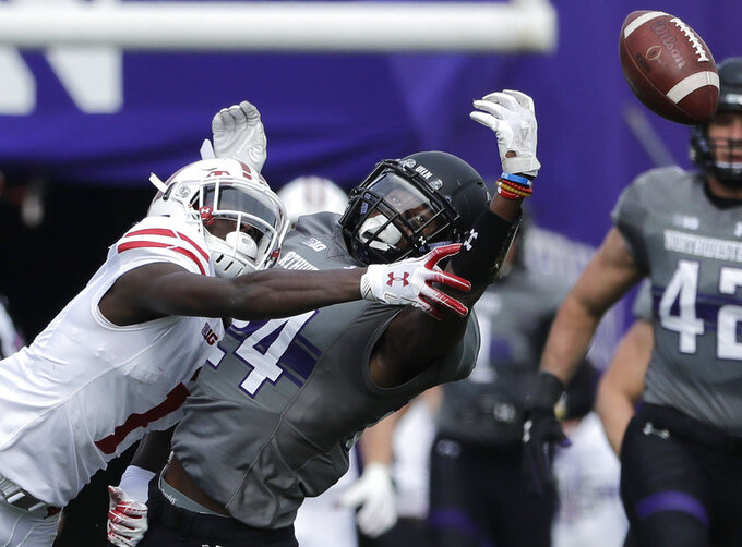 Wisconsin wide receiver Aron Cruickshank, left, can't make the catch the ball against Northwestern cornerback Montre Hartage during the first half of an NCAA college football game in Evanston, Ill., Saturday, Oct. 27, 2018. (AP Photo/Nam Y. Huh)