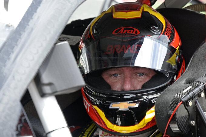 Justin Allgaier sits in his car on pit road before the restart of a NASCAR Xfinity Series auto race at Daytona International Speedway, Saturday, Aug. 28, 2021, in Daytona Beach, Fla. (AP Photo/Phelan M. Ebenhack)