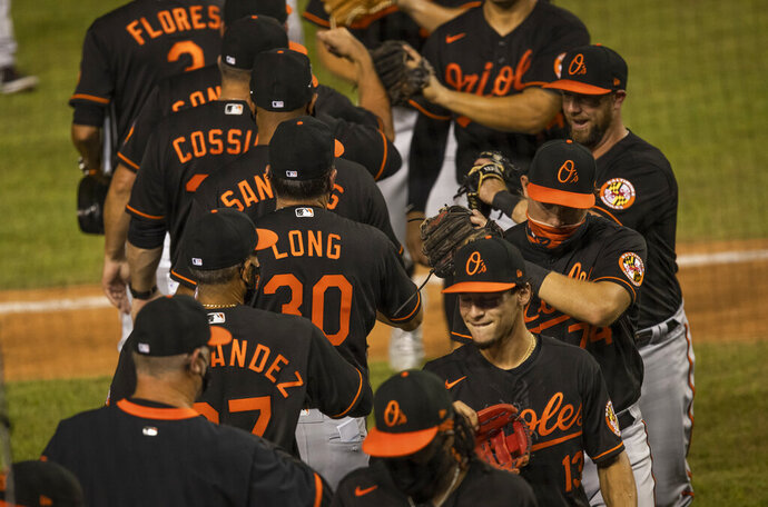 The Baltimore Orioles celebrate a baseball game victory over the Washington Nationals in Washington, Friday, Aug. 7, 2020. (AP Photo/Manuel Balce Ceneta)