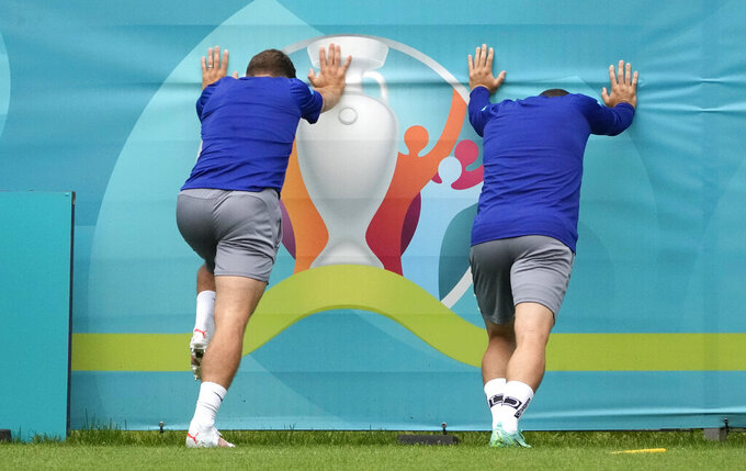 Slovakia's players attend a training session on the eve of the Euro 2020 soccer championship group E match between Poland and Slovakia at FC Zenit Training Centre in St. Petersburg, Sunday, June 13, 2021. (AP Photo/Dmitri Lovetsky)