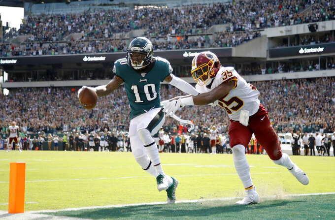 FILE - In this Sept. 8, 2019, file photo, Philadelphia Eagles' DeSean Jackson, left, scores a touchdown against Washington Redskins' Montae Nicholson during the second half of an NFL football game in Philadelphia. Jackson is hoping to show what he can do for the Eagles even at age 33. With a couple of other wide receivers banged up, he might get that chance in the season opener Sunday at Washington. Jackson played for Washington from 2014-16 and put up 1,000 yards receiving in two of those seasons. (AP Photo/Matt Rourke, File)