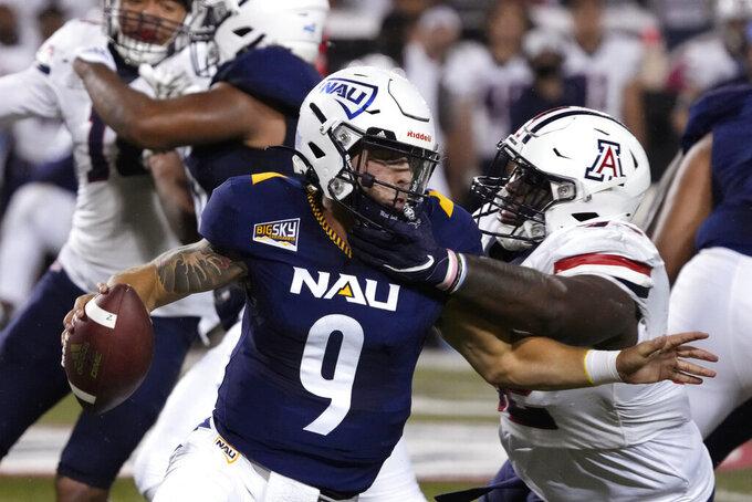 Arizona defensive lineman Kyon Barrs pressures Northern Arizona quarterback Jeff Widener (9) during the first half of an NCAA college football game, Saturday, Sept. 18, 2021, in Tucson, Ariz. (AP Photo/Rick Scuteri)