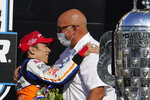 Takuma Sato, of Japan, celebrates with Bobby Rahal after Sato won the Indianapolis 500 auto race at Indianapolis Motor Speedway, Sunday, Aug. 23, 2020, in Indianapolis. (AP Photo/Michael Conroy)