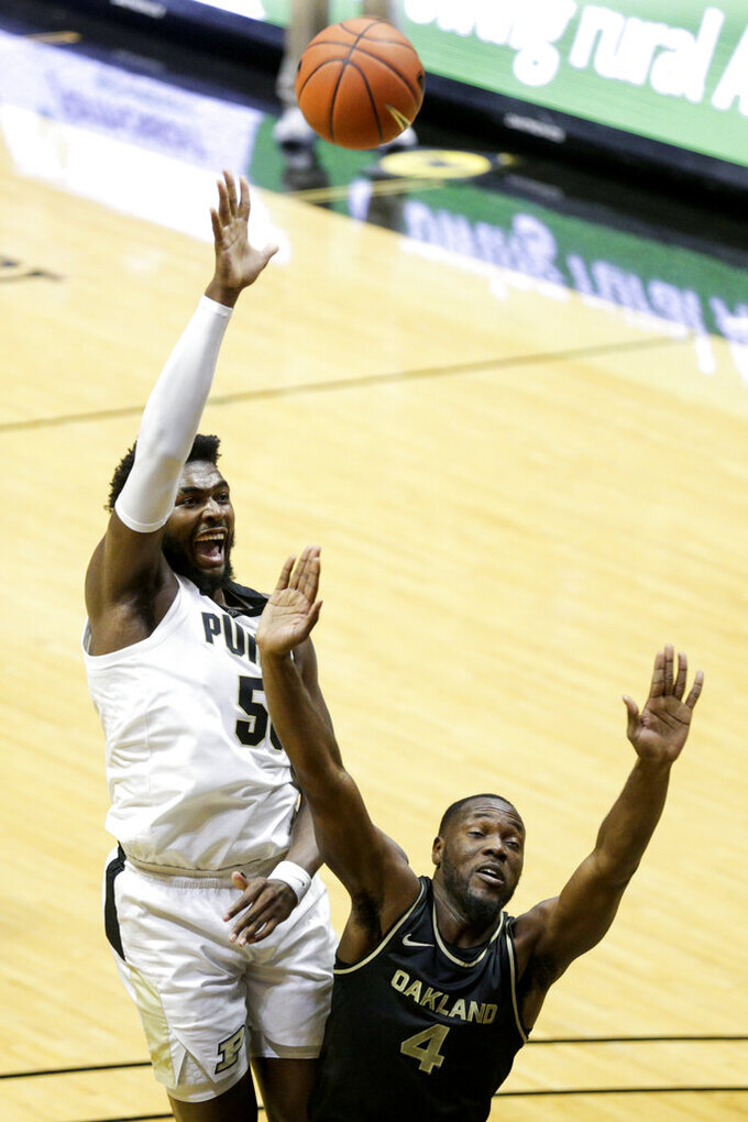 Purdue forward Trevion Williams (50) goes up for two above Oakland forward Daniel Oladapo (4) during the first half of an NCAA college basketball game Tuesday, Dec. 1, 2020 in West Lafayette, Ind. (Nikos Frazier/Journal & Courier via AP)