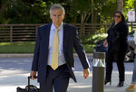 Lee Elbaz's attorney Barry Pollack arrives at federal court for jury selection in her trial in Greenbelt, Md., Tuesday July 16, 2019. Elbaz was CEO of an Israel-based company called Yukom Communications. She is accused of engaging in a scheme to dupe investors through the sale and marketing of financial instruments known as