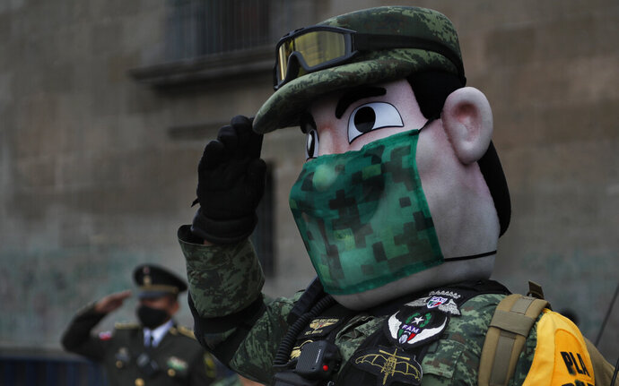 An army mascot salutes during the annual Independence Day military parade in Mexico City's main square of the capital, the Zócalo, Wednesday, Sept. 16, 2020. Mexico celebrates the anniversary of its independence uprising of 1810. (AP Photo/Marco Ugarte)