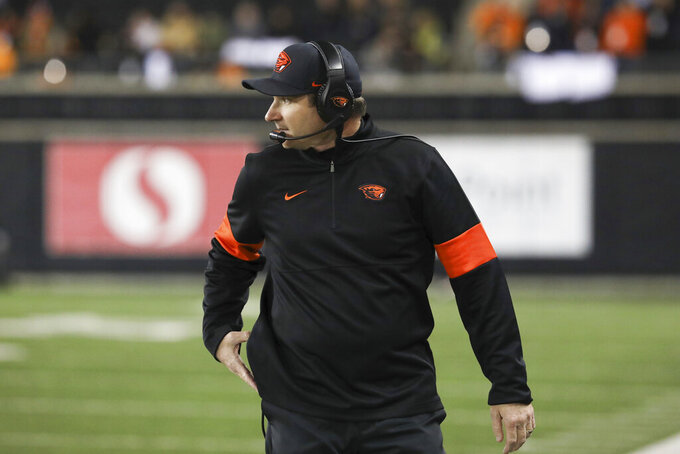 Oregon State head coach Jonathan Smith watches the field during the second half of an NCAA college football game against Washington in Corvallis, Ore., Friday, Nov. 8, 2019. Washington won 19-7. (AP Photo/Amanda Loman)