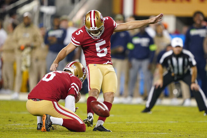 FILE - In this Monday, Nov. 11, 2019. file photo, San Francisco 49ers kicker Chase McLaughlin (5) kicks a field goal against the Seattle Seahawks during the first half of an NFL football game in Santa Clara, Calif. Kickers across the NFL are struggling to put the ball between the uprights this season. The 79.7 percent conversion rate is the league's lowest number since 2003 when kickers hit 79.2 percent and missed 198 field goals. (AP Photo/Tony Avelar, File)