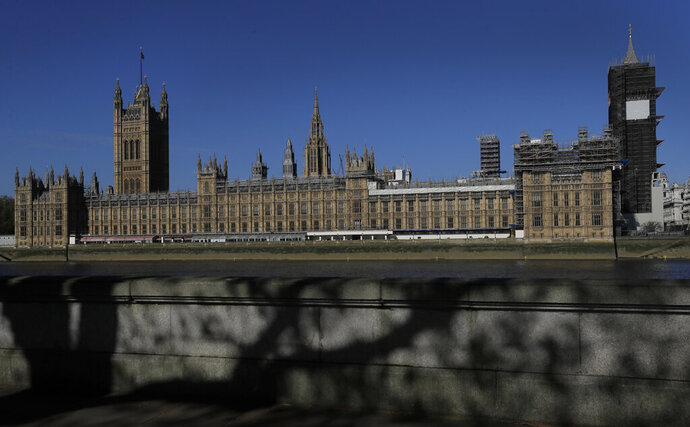 FILE - In this Tuesday, April 21, 2020 file photo, the sun shines above Britain's Houses of Parliament as the country is in lockdown to help curb the spread of coronavirus, in London. The conviction of a British lawmaker for sexual assault, and the arrest of another on rape allegations, are increasing pressure on Britain's political leaders to confront a political culture that has often let abuse go unchecked. (AP Photo/Kirsty Wigglesworth, File)