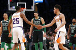 Phoenix Suns guard Devin Booker, right, celebrates with Mikal Bridges, left, during the second half of an NBA basketball game against the Boston Celtics, Saturday, Jan. 18, 2020, in Boston. (AP Photo/Mary Schwalm)