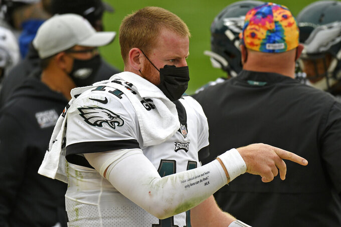 Philadelphia Eagles quarterback Carson Wentz (11) walks on the sideline during the second half of an NFL football game against the Pittsburgh Steelers in Pittsburgh, Sunday, Oct. 11, 2020. (AP Photo/Don Wright)