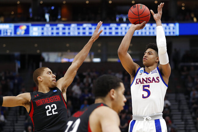 Northeastern guard Donnell Gresham Jr. (22) defends as Kansas guard Quentin Grimes (5) shoots in the first half during a first round men's college basketball game in the NCAA Tournament, Thursday, March 21, 2019, in Salt Lake City. (AP Photo/Jeff Swinger)