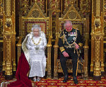 Britain's Queen Elizabeth II, with Prince Charles, delivers the Queen's Speech at the official State Opening of Parliament in London, Monday Oct. 14, 2019. (Victoria Jones/Pool via AP)