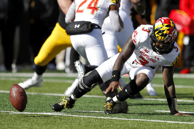 Maryland quarterback Tyrrell Pigrome (3) fumbles the ball during the second half of an NCAA college football game against Iowa, Saturday, Oct. 20, 2018, in Iowa City, Iowa. Iowa defensive end Anthony Nelson recovered the ball in the end zone for a touchdown. Iowa won 23-0. (AP Photo/Charlie Neibergall)