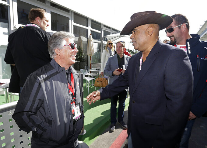 FILE - In this Nov. 18, 2012, file photo, Mario Andretti, left, talks to Willy T. Ribbs before the Formula One U.S. Grand Prix auto race at the Circuit of the Americas in Austin, Texas. IndyCar is making an improved push to diversify its fanbase and its driving field. Ribbs and George Mack are the only two drivers to ever start an Indianapolis 500. (AP Photo/Darron Cummings, File)
