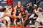 Toronto Raptors' DeAndre Bembry (95) looks to pass the ball under pressure from Oklahoma City Thunder's Lugeuntz Dort (5), Isaiah Roby, left, and Ty Jerome (16) during the first quarter of a basketball game Sunday, April 18, 2021, in St. Petersburg, Fla. (AP Photo/Steve Nesius)