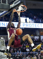 Florida State's Phil Cofer (0) dunks against Wake Forest during the second half of an NCAA college basketball game on Saturday, March 9, 2019 in Winston-Salem, N.C. Florida State beat Wake Forest 65 to 57. (AP Photo/Woody Marshall)