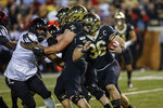 Wake Forest running back Cade Carney, right, carries the football against Louisville during the first half of an NCAA college football game in Winston-Salem, N.C., Saturday, Oct. 12, 2019. (AP Photo/Nell Redmond)