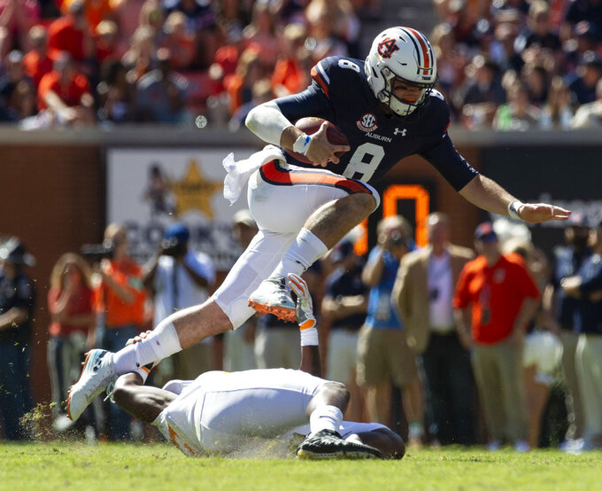 Auburn quarterback Jarrett Stidham (8) gets loose during the second half of an NCAA college football game against Tennessee, Saturday, Oct. 13, 2018, in Auburn, Ala. (AP Photo/Vasha Hunt)