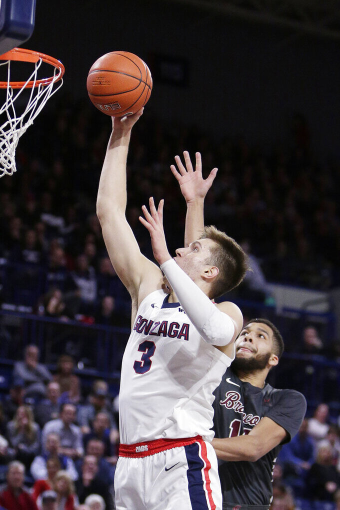 CORRECTS TO SECOND HALF, INSTEAD OF FIRST - Gonzaga forward Filip Petrusev shoots in front of Santa Clara forward Keshawn Justice during the second half of an NCAA college basketball game in Spokane, Wash., Thursday, Jan. 16, 2020. Gonzaga won 104-54. (AP Photo/Young Kwak)