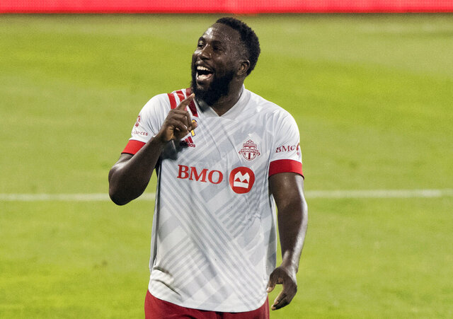 Toronto FC's Jozy Altidore reacts after scoring during the second half of an MLS soccer match against the Montreal Impact, Wednesday, Sept. 9, 2020, in Montreal. (Graham Hughes/The Canadian Press via AP)