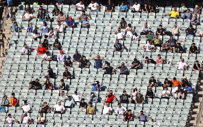 Fans watch play during the Euro 2020 soccer championship group A match between Wales and Switzerland at Baku Olympic Stadium in Baku, Azerbaijan, Saturday, June 12, 2021. (AP Photo/Naomi Baker, Pool)
