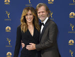 FILE - In this Sept. 17, 2018 file photo, Felicity Huffman, left, and William H. Macy arrive at the 70th Primetime Emmy Awards in Los Angeles.  Huffman and Lori Loughlin were charged along with nearly 50 other people Tuesday, March 12, 2019, in a scheme in which wealthy parents bribed college coaches and insiders at testing centers to help get their children into some of the most elite schools in the country, federal prosecutors said. Court papers said a cooperating witness met with Huffman and Macy, at their Los Angeles home and explained the scam to them. The cooperator told investigators that Huffman and her spouse