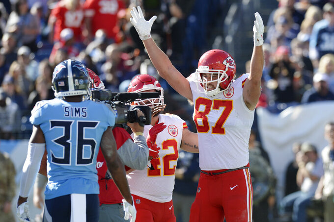 Kansas City Chiefs tight end Travis Kelce (87) celebrates after scoring a touchdown against the Tennessee Titans in the first half of an NFL football game Sunday, Nov. 10, 2019, in Nashville, Tenn. (AP Photo/Mark Zaleski)