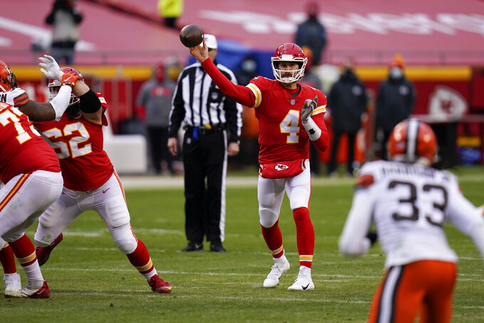 Kansas City Chiefs quarterback Chad Henne throws a pass during the second half of an NFL divisional round football game against the Cleveland Browns, Sunday, Jan. 17, 2021, in Kansas City. (AP Photo/Jeff Roberson)