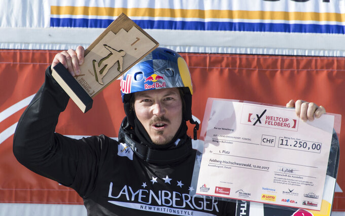 FILE - In this Feb. 12, 2017, file photo, winner Alex Pullin from Australia cheers at the snow boarding cross World Cup in Feldberg, Germany. Two-time world snowboard champion and Winter Olympian Alex Pullin drowned Wednesday, July 8, 2020, while spearfishing on Australia's Gold Coast. (Patrick Seeger/dpa via AP, File)