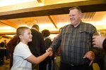 Montana Senator Jon Tester shakes hands with Jack Pinski Tuesday, Nov. 6, 2018, at his election party in Great Falls, Mont.  (Thom Bridge/Independent Record via AP)