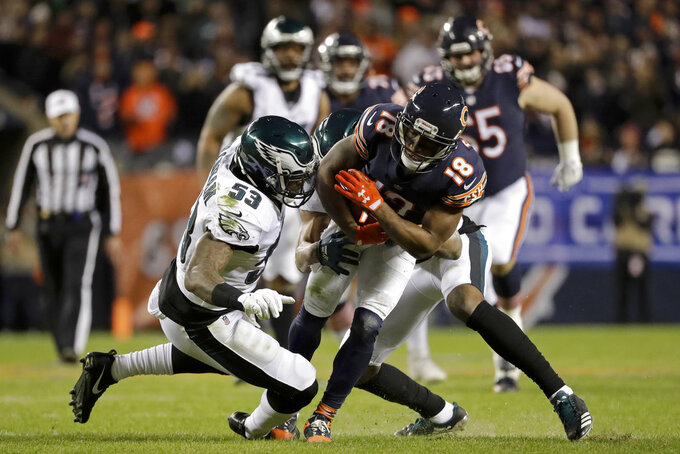 Chicago Bears wide receiver Taylor Gabriel (18) is tackled by Philadelphia Eagles outside linebacker Nigel Bradham (53) and cornerback Rasul Douglas, rear, during the first half of an NFL wild-card playoff football game Sunday, Jan. 6, 2019, in Chicago. (AP Photo/Nam Y. Huh)