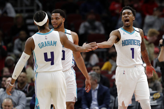 Charlotte Hornets guard Malik Monk, right, celebrates with guard Devonte' Graham (4) after scoring during the second half of the team's NBA basketball game against the Chicago Bulls in Chicago, Thursday, Feb. 20, 2020. The Hornets won 103-93. (AP Photo/Nam Y. Huh)