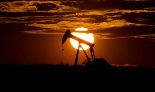 FILE - In this Wednesday, April 8, 2020 file photo, the sun sets behind an idle pump jack near Karnes City, USA. As the world's nations prepare to gather for another climate summit next month, Nov. 2021 in Glasgow, the OPEC oil cartel is reminding that, in their view, crude will continue to be the leading source of energy for decades, especially as the world's less-wealthy countries seek higher growth and standards of living. (AP Photo/Eric Gay, File)