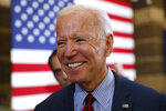Democratic presidential candidate former Vice President Joe Biden greets local residents during a community event, Wednesday, Oct. 16, 2019, in Davenport, Iowa. (AP Photo/Charlie Neibergall)