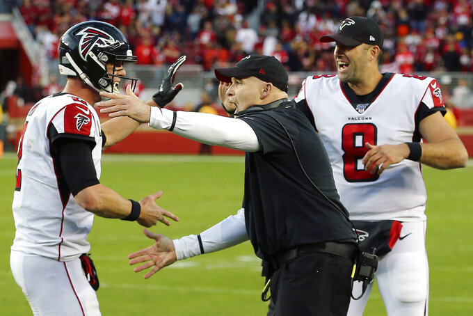 Atlanta Falcons head coach Dan Quinn, center, celebrates with quarterbacks Matt Ryan, left, and Matt Schaub (8) during the second half of an NFL football game against the San Francisco 49ers in Santa Clara, Calif., Sunday, Dec. 15, 2019. (AP Photo/John Hefti)