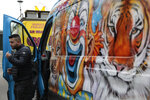 A circus worker leaves his van during a protest Tuesday, Jan.26, 2021. French lawmakers start debating Tuesday a bill that would ban using wild animals in traveling circuses and keeping dolphins and whales in captivity in marine parks, amid other measures to better protect animal welfare. Circus workers stage a protest outside the National Assembly to denounce what they consider