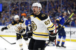 Boston Bruins left wing Brad Marchand (63) celebrates after scoring a goal against the St. Louis Blues during the first period of Game 6 of the NHL hockey Stanley Cup Final Sunday, June 9, 2019, in St. Louis. (AP Photo/Jeff Roberson)
