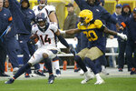 Denver Broncos wide receiver Courtland Sutton (14) runs with the ball after catching a pass as Green Bay Packers cornerback Kevin King (20) defends during the second half of an NFL football game Sunday, Sept. 22, 2019, in Green Bay, Wis. (AP Photo/Mike Roemer)