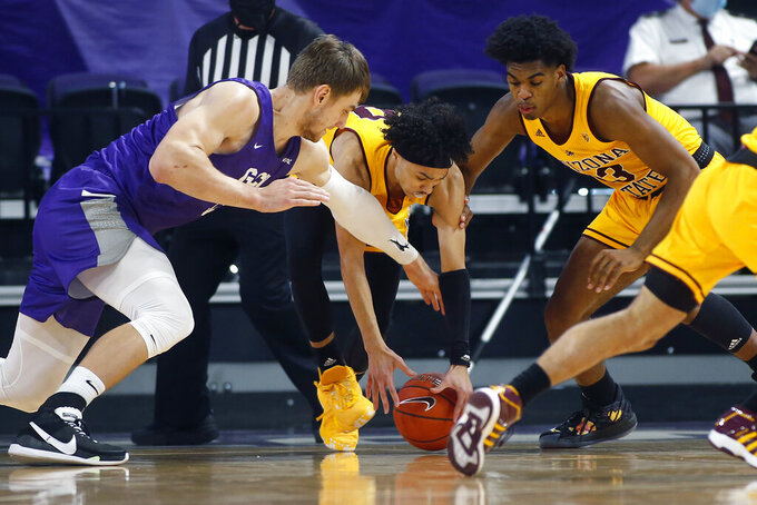CORRECTS MONTH TO DEC. NOT JAN. - Arizona State guards Jaelen House, center, and Josh Christopher (13) battle for a loose ball with Grand Canyon center Asbjorn Midtgaard (33) during the first half of an NCAA college basketball game, Sunday, Dec. 13, 2020, in Phoenix. (AP Photo/Ralph Freso)