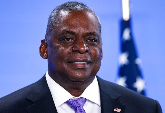 United State Secretary of Defense Lloyd Austin poses for photographers as he arrives at NATO headquarters in Brussels, Wednesday, April 14, 2021. (Kenzo Tribouillard, Pool via AP)