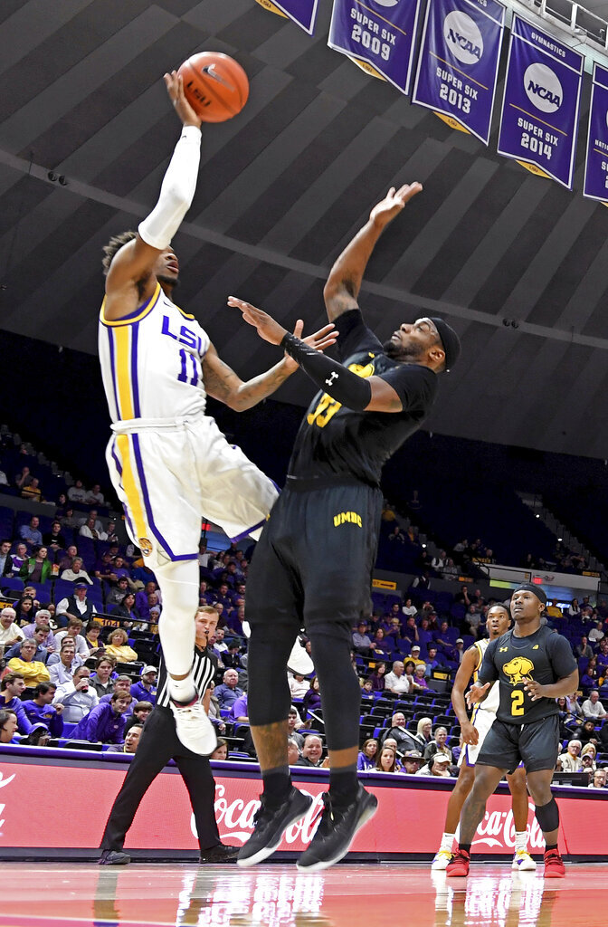 LSU guard Charles Manning Jr. (11) puts the ball up over Maryland-Baltimore County forward Arkel Lamar (33) during the first half of an NCAA college basketball game Tuesday, Nov. 19, 2019, in Baton Rouge, La. LSU won 77-50. (AP Photo/Bill Feig)