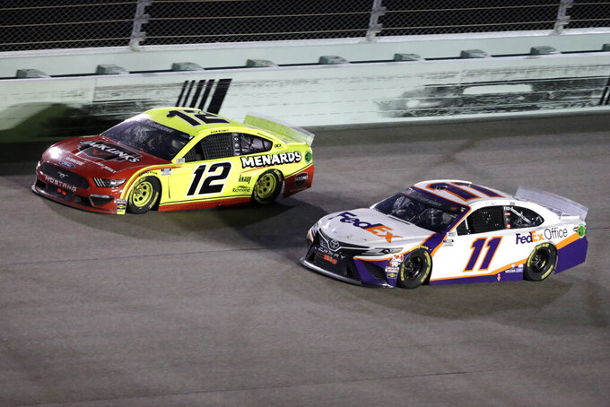 Ryan Blaney (12) and Denny Hamlin (11) battle for the lead during a NASCAR Cup Series auto race Sunday, June 14, 2020, in Homestead, Fla. (AP Photo/Wilfredo Lee)
