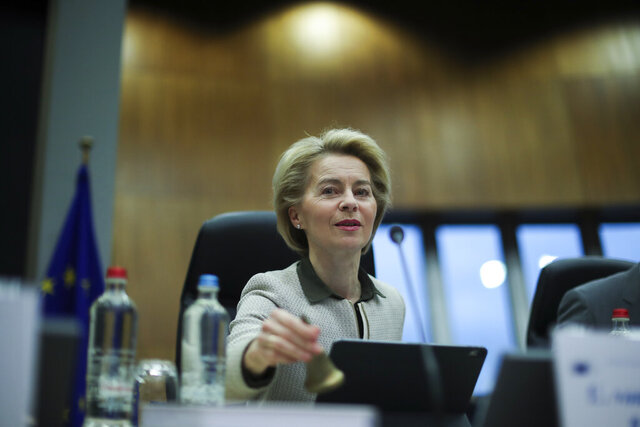 European Commission President Ursula von der Leyen rings a bell to signal the start of a weekly College of Commissioners meeting at the EU headquarters in Brussels, Wednesday, Feb. 26, 2020. (AP Photo/Francisco Seco)