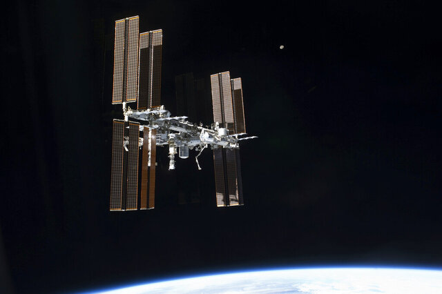 FILE - This July 19, 2011 photo of the International Space Station was taken from the space shuttle Atlantis. On Tuesday, Sept. 29, 2020, NASA said that the two Russians and one American on board were awakened late Monday to hurriedly seal hatches between compartments and search for the ongoing leak, which appeared to be getting worse. It was the third time in just over a month that the crew had to isolate themselves on the Russian side, in an attempt to find the growing leak.  (NASA via AP)