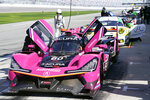 Cars line up on pit road, including the Meyer Stark Racing Acura DPi (60) before a practice session for the Rolex 24 hour race at Daytona International Speedway, Friday, Jan. 29, 2021, in Daytona Beach, Fla. (AP Photo/John Raoux)