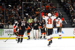 Calgary Flames' Michael Stone (26) celebrates after scoring against the Anaheim Ducks during the second period of an NHL hockey game, Sunday, Oct. 20, 2019, in Anaheim, Calif. (AP Photo/Marcio Jose Sanchez)